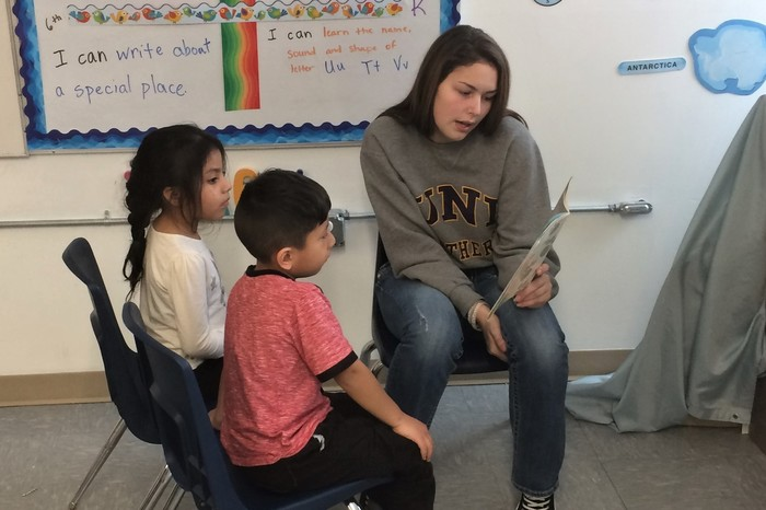 High School student reading story in Spanish.
