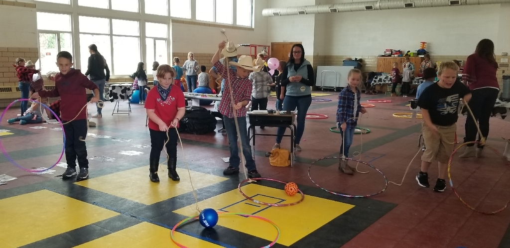 Students throw their hula hoop ropes out to catch a number to round to the nearest ten!