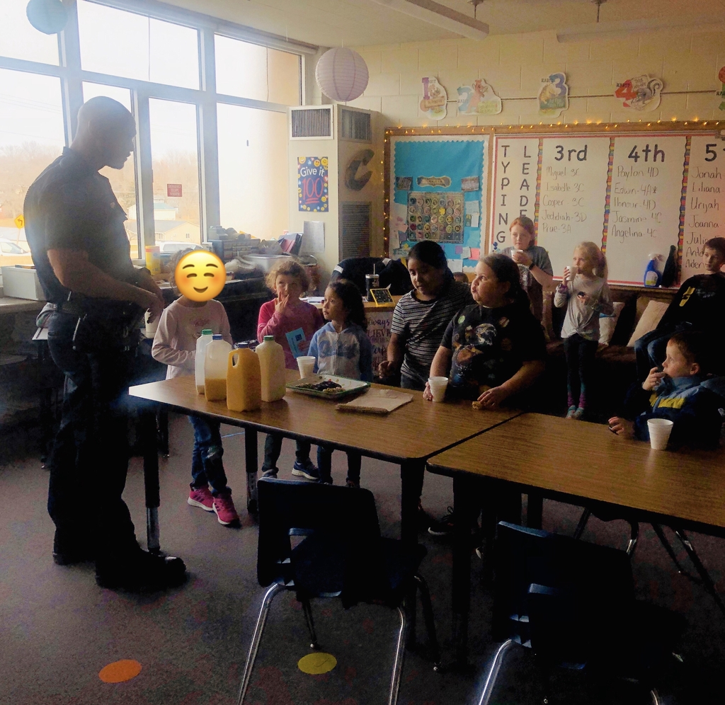 The kids enjoyed asking Officer Fitzpatrick questions about being a cop!